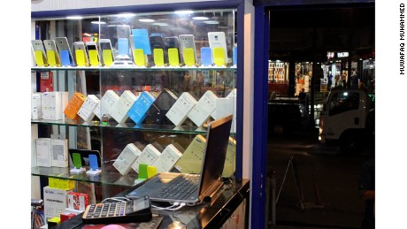 Smartphone cases can be seen in the window of an electronics shop in Mosul, Iraw.