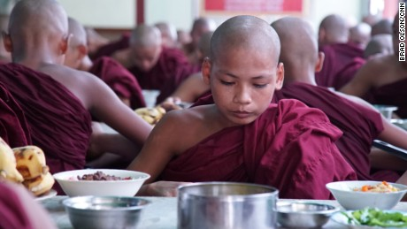 A novice monk eats lunch at ZayTaWon DammarYone Monastery, Mingalardone township near Yangon on Wednesday September 20.