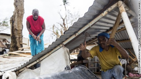 LOIZA, PUERTO RICO - SEPTEMBER 22: Residents dismantle a roof days after Hurricane Maria made landfall,  on September 22, 2017 in Loiza, Puerto Rico. Many on the island have lost power, running water, and cell phone service after Hurricane Maria, a category 4 hurricane, passed through. (Photo by Alex Wroblewski/Getty Images)