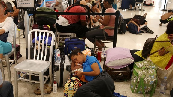 Yancy Leon rests at the Luis Muñoz Marin International Airport near San Juan on September 25. She