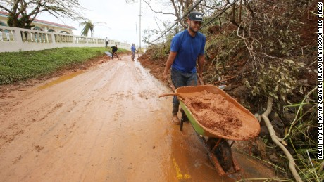 Residents in Quebradillas are trying to begin cleanup on their own.