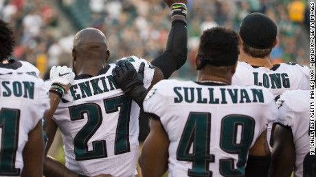 PHILADELPHIA, PA - AUGUST 24: Malcolm Jenkins #27 of the Philadelphia Eagles holds his fist in the air while Tre Sullivan #49 stands behind him and Chris Long #56 puts his arm on his shoulder during the national anthem prior to the preseason game against the Miami Dolphins at Lincoln Financial Field on August 24, 2017 in Philadelphia, Pennsylvania. (Photo by Mitchell Leff/Getty Images)