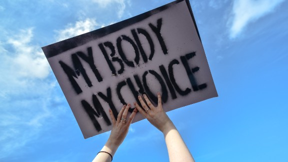 """A protester holds a """"My Body My Choice'"""" sign during the Strike 4 Repeal demonstration in Dublin in March."""