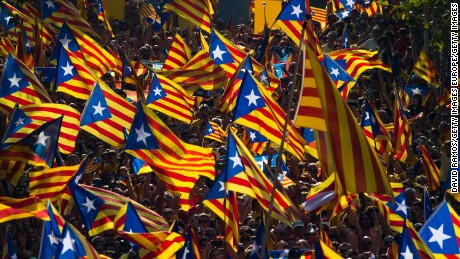 BARCELONA, SPAIN - SEPTEMBER 11:  Demonstrators wave Pro-Independence Catalan flags during a demonstration as part of the celebrations of the National Day of Catalonia on September 11, 2014 in Barcelona, Spain. Thousands of Catalans celebrating the 'Diada de Catalunya' are using it as an opportunity to hold demonstrations to demand the right to hold a self-determination referendum next November.  (Photo by David Ramos/Getty Images)