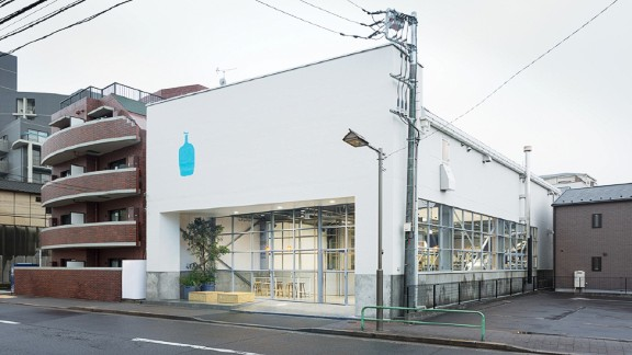 Blue Bottle Coffee's former Japanese head office was a  derelict warehouse before Schemata Architects converted it into a versatile workspace.