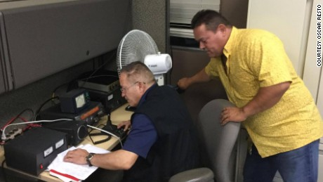 Raul Gonzalez and Jose Santiago work to maintain the communication infrastructure they set up between ham radio operators in the Monacillo Control Center.