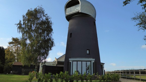This 125-year-old disused windmill in Suffolk UK was transformed into a luxury guest house by Beech Architects.