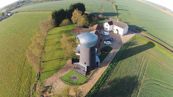 The windmill, which was a derelict stump for decades, contains two bedrooms, a large kitchen and a viewing pad that offers panoramic views of the surrounding countryside.