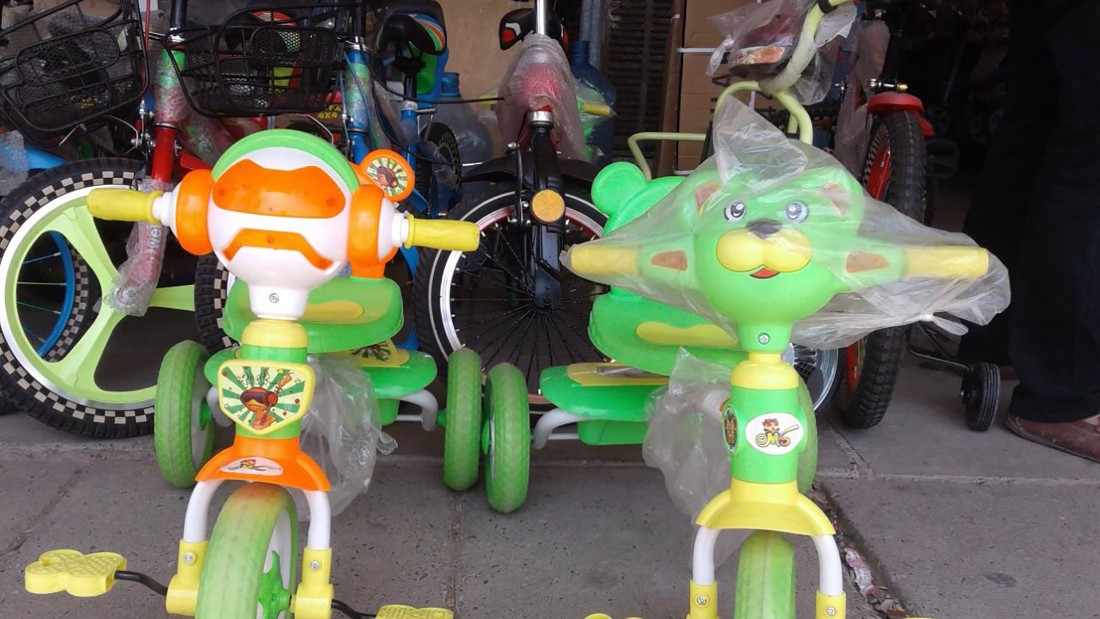 Children's bikes are displayed in a toy store in Mosul. Many toy shops were forced to close or were banned from selling items that resembled humans or animals.