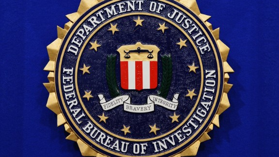 "The Federal Bureau of Investigation (FBI) seal is seen on the lectern following a press conference announcing the FBI's 499th and 500th additions to the ""Ten Most Wanted Fugitives"" list on June 17, 2013 at the Newseum in Washington, DC. (MANDEL NGAN/AFP/Getty Images)"