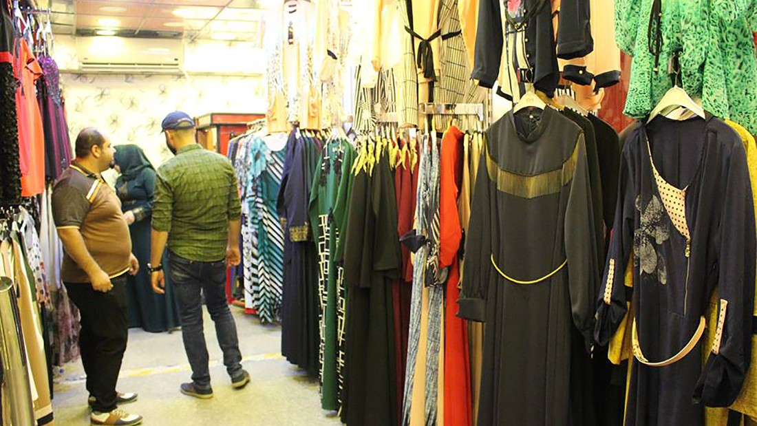 An array of woman's clothes for sale in a Mosul store.