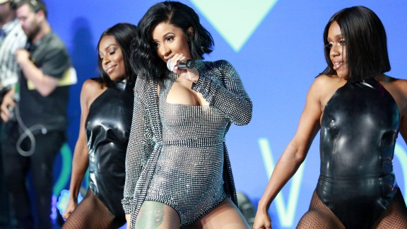 INGLEWOOD, CA - AUGUST 27:  Cardi B (C) performs during the 2017 MTV Video Music Awards at The Forum on August 27, 2017 in Inglewood, California.  (Photo by Rich Fury/Getty Images)