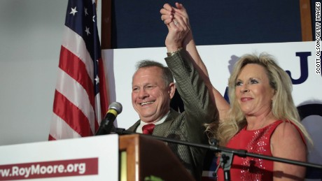MONTGOMERY, AL - SEPTEMBER 26:  Republican candidate for the U.S. Senate in Alabama, Roy Moore and his wife Kayla greet supporters at an election-night rally on September 26, 2017 in Montgomery, Alabama. Moore, former chief justice of the Alabama supreme court, defeated incumbent Luther Strange in a primary runoff election for the seat vacated when Jeff Sessions was appointed U.S. Attorney General by President Donald Trump. Moore will now face Democratic candidate Doug Jones in the general election in December.  (Photo by Scott Olson/Getty Images)