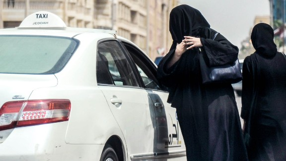 A Saudi woman prepares to get into a taxi on a main street in the Saudi coastal city of Jeddah on September 27, 2017.Saudi Arabia will allow women to drive from next June, state media said on September 26, 2017 in a historic decision that makes the Gulf kingdom the last country in the world to permit women behind the wheel. The shock announcement comes after a years-long resistance from women's rights activists, some of whom were jailed for defying the ban on female driving. / AFP PHOTO / AMER HILABI        (Photo credit should read AMER HILABI/AFP/Getty Images)