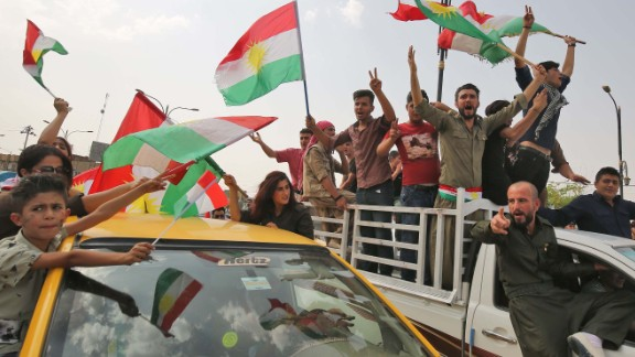 Iraqis Kurds celebrate with the Kurdish flag in the streets of the northern city of Kirkuk on September 25, 2017 as they vote in a referendum on independence.