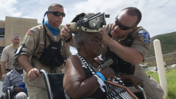 Members of the National Disaster Medical Assistance Team help people evacuate St. Thomas, one of the US Virgin Islands, on Saturday, September 9. The Department of Defense has been supporting the Federal Emergency Management Agency to help those affected by Hurricane Irma.