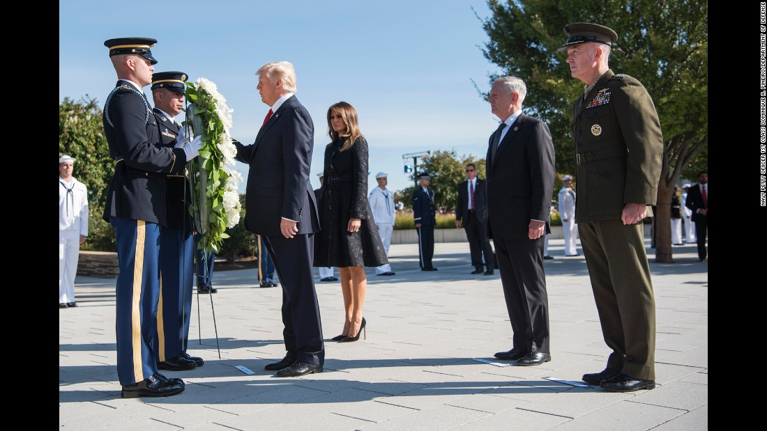 President Donald Trump, accompanied by first lady Melania Trump, participates in a wreath-laying ceremony at the Pentagon, 16 years after the September 11 terrorist attacks.