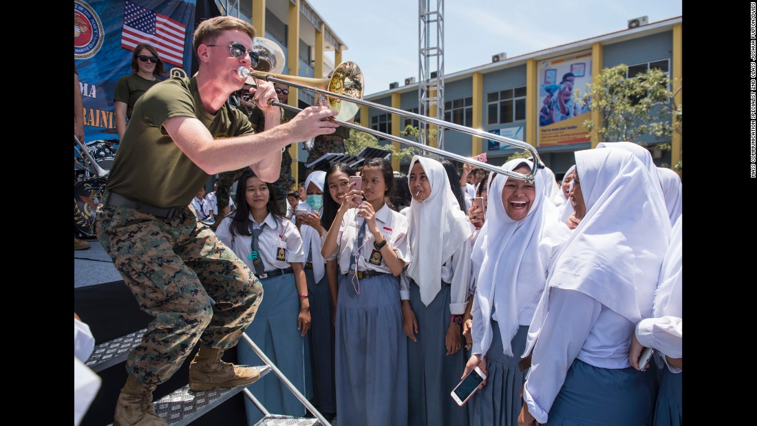 Marine Sgt. Colin Deeter plays the trombone at a high school in Surabaya, Indonesia, where troops from the United States and other countries were taking part in annual training exercises on Tuesday, September 12. Deeter is part of a Marine band, assigned to the 3rd Marine Expeditionary Force, that performs throughout the Far East.
