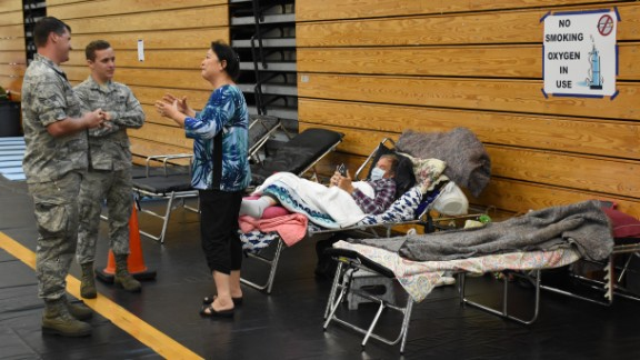 Members of the Florida Air National Guard help people at a Jacksonville high school that served as a shelter during Hurricane Irma on Saturday, September 9.