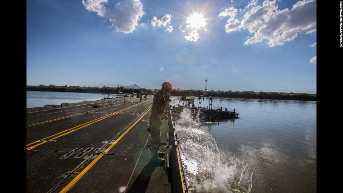 US Marines drop anchors to support a floating bridge in Blythe, California, on Monday, September 11. During a training exercise, they were tasked with constructing a bridge to span a 120-meter (394-foot) section of the Colorado River.