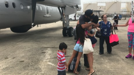Families saying goodbye before boarding the flight.