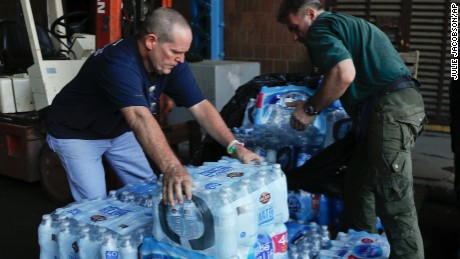 State Park employees in New York stack cases of bottled water that were donated for a relief fund to help Puerto Rico.