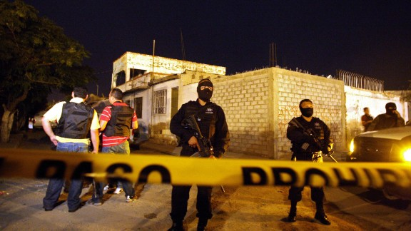 Mexican police guard the area surrounding the scene of murder, outside a drug treatment center in Ciudad Juarez, on September 3, 2009. A surge in drug-related violence the last 24 hours has seen at least 40 people killed in the troubled northern border region and President Felipe Calderon's home state. At least 18 people were killed and five wounded late August 2 when gunmen stormed into a drug treatment center in northern Mexico's violence-plagued Ciudad Juarez. Civil protection officials warned there might be more victims from the shootout. The city lies just across the border from El Paso, Texas, where feuding drug cartels are engaged in a violent struggle. AFP PHOTO/ Jesus ALCAZAR (Photo credit should read Jesus Alcazar/AFP/Getty Images)