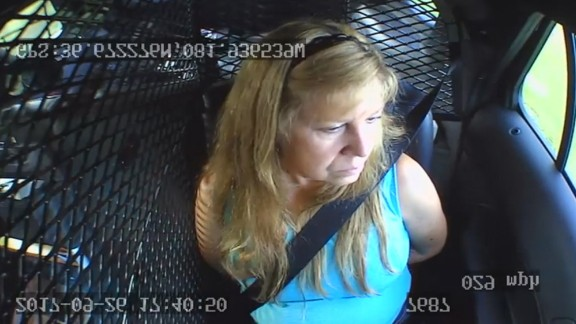 Shelia Warren sits in the back of a patrol car after being arrested in Washington County, Virginia.