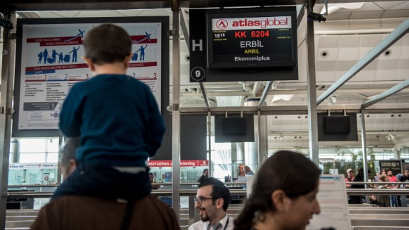 Passengers flying to Erbil wait to check in for their flight at Ataturk International airport in Istanbul on Thursday.