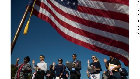 Immigrants take the Oath during a naturalization ceremony on September 15 in New Jersey.