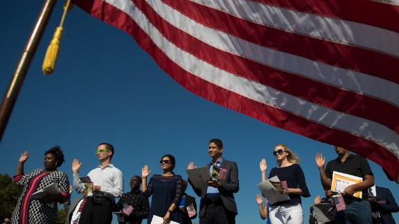 JERSEY CITY, NJ - SEPTEMBER 15: An American flag billows in the wind as immigrants stand and take the oath of allegiance to the United States during a naturalization ceremony at Liberty State Park, September 15, 2017 in Jersey City, New Jersey. To mark Citizenship Day, 35 immigrants became United States citizens during the ceremony. (Photo by Drew Angerer/Getty Images)