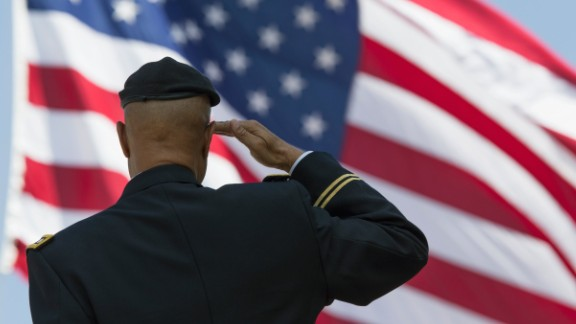 Retired Milton S Herring saluting US flag, Los Angeles National Cemetery Annual Memorial Event, California. (Photo By: Visions of America/UIG via Getty Images)