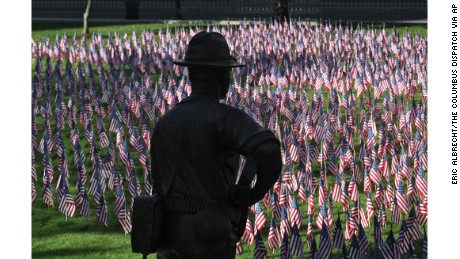 A man pauses on September 11, 2015, at the Ohio Statehouse lawn in Columbus to memorialize victims of the 9/11 attacks.