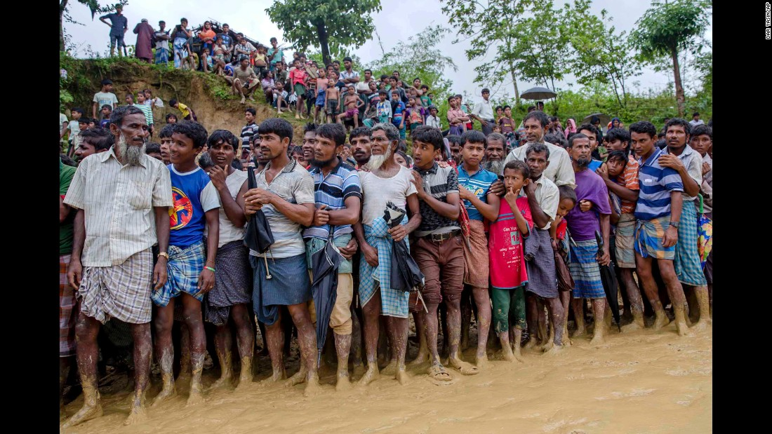 Rohingya men stand in line September 19 to collect food distributed by aid agencies in Balukhali refugee camp in Bangladesh.