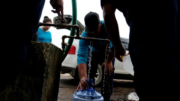 September 26, 2017. Puerto Rico. Utuado Puerto Rico. Employee of Aqueducts and Sewers Authority provide water to citizens of the remote village of Barrio Caguana, Utuado. After Hurricane Maria in Puerto Rico.