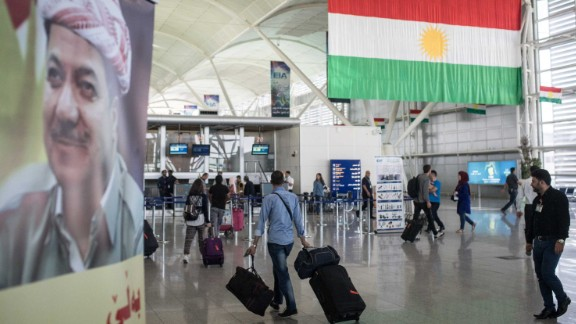 Travelers pass through Erbil International Airport on September 27.