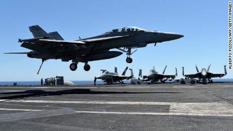"An F/A-18F Super Hornet lands on the US navy's super carrier USS Dwight D. Eisenhower (CVN-69) (""Ike"") in the Mediterranean Sea on July 6, 2016.