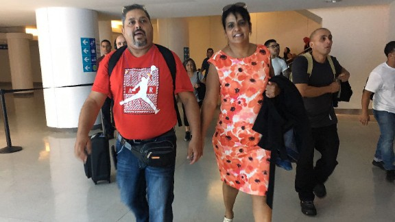Edgardo and Carmen Delgado are relieved to be back in Puerto Rico after arriving at San Juan's airport.