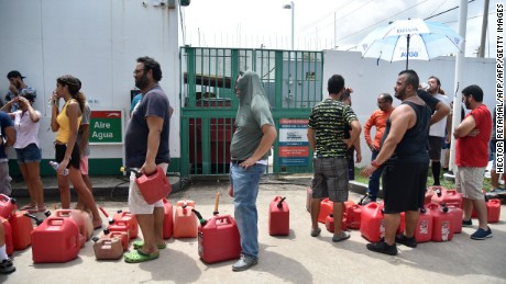 People waiting line to buy gas are seen in Rio Hondo, Bayamon, Puerto Rico, on September 22, 2017.  Puerto Rico battled dangerous floods Friday after Hurricane Maria ravaged the island, as rescuers raced against time to reach residents trapped in their homes and the death toll climbed to 33. Puerto Rico Governor Ricardo Rossello called Maria the most devastating storm in a century after it destroyed the US territory's electricity and telecommunications infrastructure.  / AFP PHOTO / HECTOR RETAMAL        (Photo credit should read HECTOR RETAMAL/AFP/Getty Images)