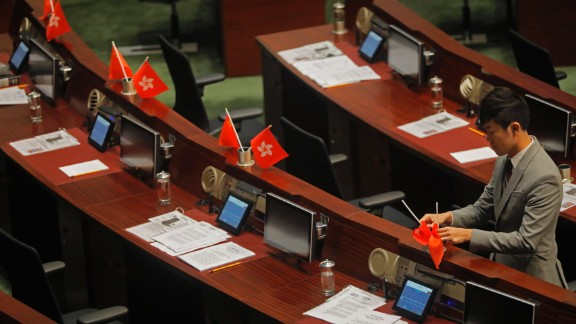 """Lawmaker Cheng Chung-tai was found guilty of """"desecrating"""" Hong Kong's flag by flipping it over during a parliamentary session."""