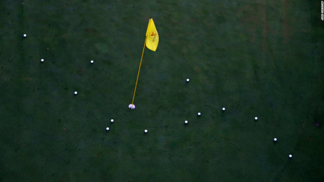 The practice green is used before the start of play on the third day of the Presidents Cup at Liberty National Golf Club in Jersey City, N.J., Saturday, Sept. 30, 2017. (AP Photo/Julio Cortez)
