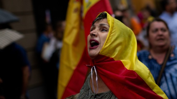 Anti-independence demonstrators march waving Spanish flags against the referendum downtown Barcelona on September 30. The planned referendum is due to be held Sunday by the pro-independence Catalan government but Spain's government calls the vote illegal, since it violates the constitution, and the country's Constitutional Court has ordered it suspended.