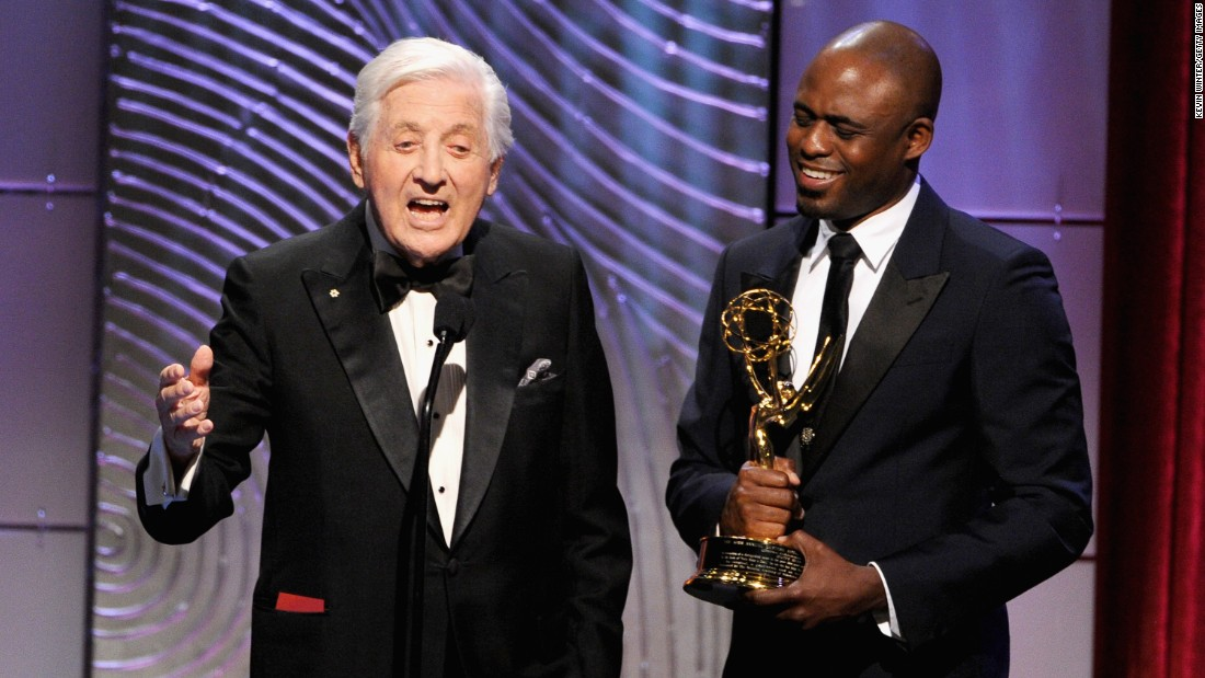 TV personality Wayne Brady presents Monty Hall with The Lifetime Achievement Award onstage during the 40th Annual Daytime Emmy Awards  on June 16, 2013, in Beverly Hills.