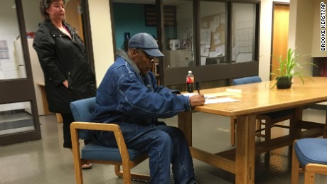 O.J. Simpson signs documents at the Lovelock Correctional Center, Saturday, Sept. 30, 2017, in Lovelock, Nevada. Simpson was released from the Lovelock Correctional Center in northern Nevada early Sunday, October. 1, 2017.