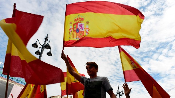 People attend a demonstration against a referendum on independence for Catalonia on October 1 in Madrid, Spain.