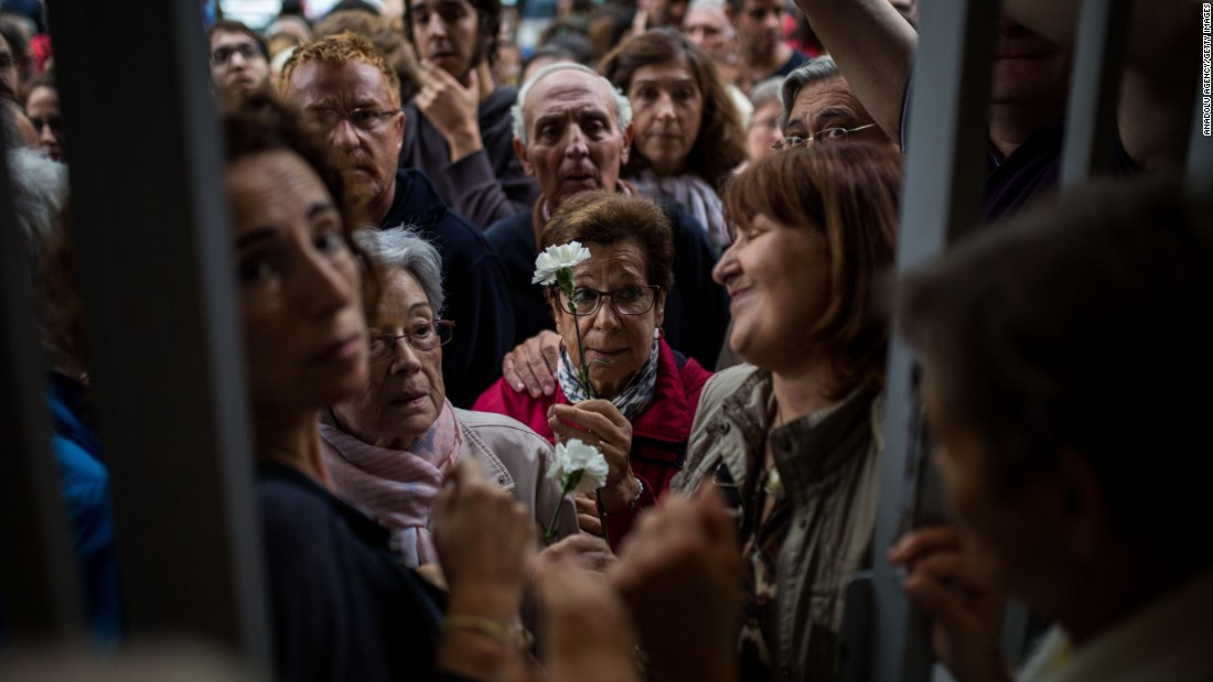 People wait at the doors of the Moises Broggi school to start voting during the Catalan independence referendum in Barcelona, Spain on October 1.