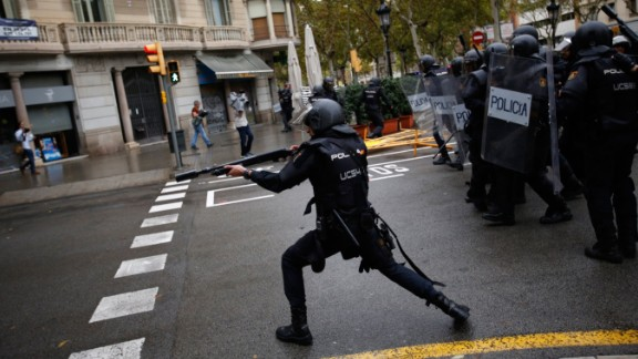 Spanish riot police shoot rubber bullets at people trying to reach a voting site designated by the Catalan government in Barcelona. The deputy mayor of Barcelona said police fired rubber bullets at people as they attempted to vote in the referendum, which Spain's top court has declared illegal. There were reports that police in Girona, Spain, used batons.