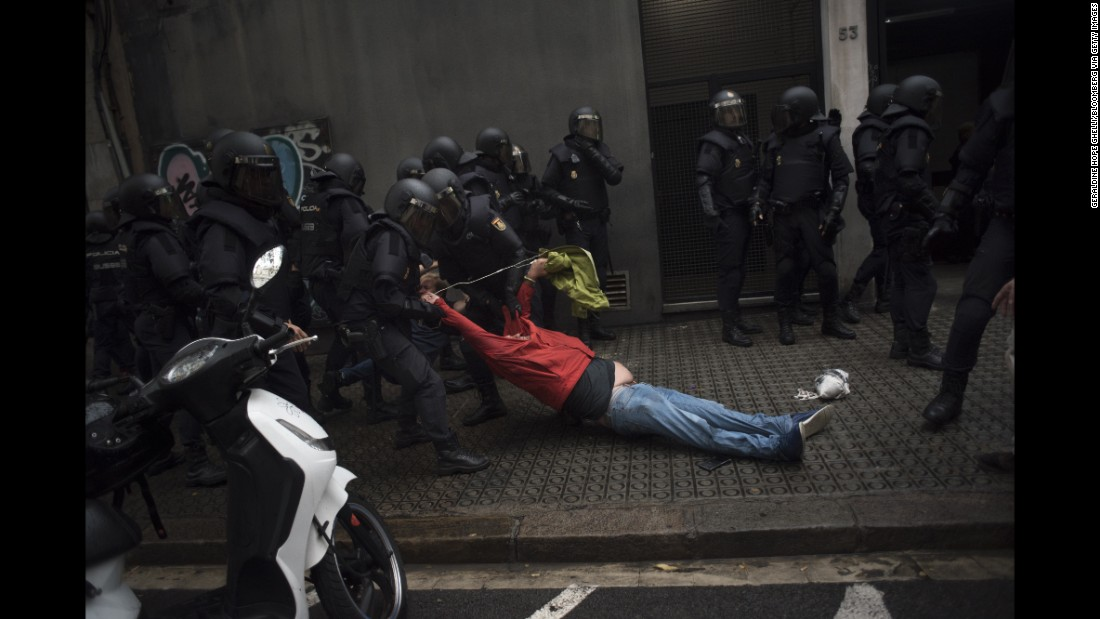 Riot police drag a member of the public away from a school being used as a polling station. Regional authorities said 337 people were injured after Madrid deployed the national police force to close down polling stations. Catalan emergency services confirmed the number to CNN.