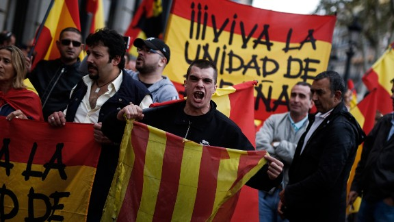 A protestor shouts as he holds a Catalan flag during a demonstration called by far-right groups against a referendum on independence for Catalonia, on October 01, 2017 in Barcelona.  / AFP PHOTO / PAU BARRENA        (Photo credit should read PAU BARRENA/AFP/Getty Images)