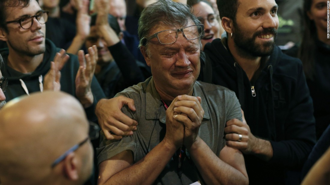 A member of the Catalan National Assembly cries at the end of the voting day on October 1.